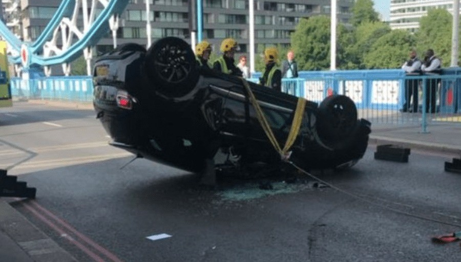 Driver Arrested After Car Overturns On Tower Bridge In London