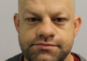 A burglar who stole a lifetime's collection of antique coins from a world-renowned collector has been sentenced in his absence