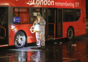 Officers investigating the stabbing of three people on a bus in Tower Hamlets in the early hours of Wednesday morning have charged a man