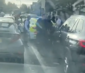Met Police Dog Handler crushed by Armed response vehicle during robbery operation in Mitcham